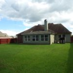 Large backyard at 211 Talon Rd Youngsville LA 70592 Home for sale